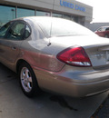 ford taurus 2005 tan sedan se gasoline 6 cylinders front wheel drive automatic 14224
