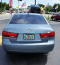 hyundai sonata 2010 lt  blue sedan gasoline 4 cylinders front wheel drive automatic 33021
