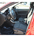 ford focus 2010 red sedan se gasoline 4 cylinders front wheel drive automatic with overdrive 77065