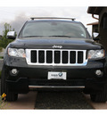 jeep grand cherokee 2011 black suv overland gasoline 8 cylinders 4 wheel drive automatic 99352