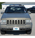 jeep grand cherokee 1997 green suv limited gasoline 8 cylinders 4 wheel drive automatic 77388