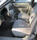 toyota corolla 2000 lt  brown sedan ve gasoline 4 cylinders front wheel drive automatic 77379