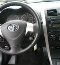 toyota corolla 2009 black sedan gasoline 4 cylinders front wheel drive automatic 13502