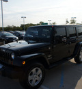 jeep wrangler unlimited 2010 black suv sahara gasoline 6 cylinders 4 wheel drive automatic 76210