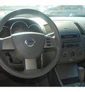 nissan altima 2006 black sedan 2 5 sl gasoline 4 cylinders front wheel drive 4 speed automatic 77090