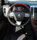 cadillac sts 2011 cream sedan gasoline 6 cylinders rear wheel drive automatic 76087