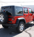 jeep wrangler unlimited 2011 red suv rubicon gasoline 6 cylinders 4 wheel drive automatic 80229