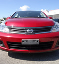 nissan versa 2010 dk  red sedan 1 8 s gasoline 4 cylinders front wheel drive automatic 33177