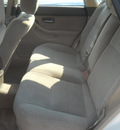 subaru legacy 2002 white wagon outback gasoline 4 cylinders all whee drive automatic with overdrive 99212