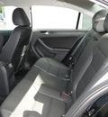 volkswagen jetta 2012 black hatchback se with convenience pzev gasoline 5 cylinders front wheel drive 5 speed manual 98226