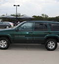 jeep grand cherokee 1998 green suv gasoline 6 cylinders rear wheel drive automatic 76087
