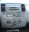 nissan versa 2010 silver hatchback 1 8 s gasoline 4 cylinders front wheel drive automatic 75228
