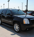 gmc yukon 2010 black suv denali flex fuel 8 cylinders all whee drive automatic 76087