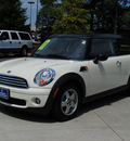 mini cooper clubman 2009 off white hatchback gasoline 4 cylinders front wheel drive 6 speed manual 27616