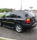 gmc envoy 2009 black suv gasoline 6 cylinders 4 wheel drive automatic 13502