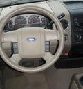 ford f 150 2006 beige xlt flex fuel 8 cylinders 4 wheel drive automatic 98632