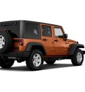 jeep wrangler unlimited 2011 orange suv sport gasoline 6 cylinders 4 wheel drive automatic 33021
