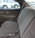 ford taurus 2002 beige wagon sel gasoline 6 cylinders front wheel drive automatic with overdrive 60546