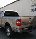 ford f 150 2005 beige lariat gasoline 8 cylinders 4 wheel drive automatic 27215