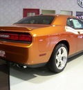 dodge challenger 2011 orange coupe r t gasoline 8 cylinders rear wheel drive not specified 44024