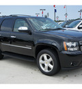 chevrolet tahoe 2011 black suv ltz flex fuel 8 cylinders 2 wheel drive automatic with overdrive 77090