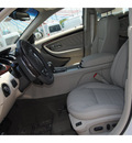 ford taurus 2011 white sedan limited gasoline 6 cylinders front wheel drive 6 speed automatic 77388
