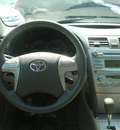 toyota camry hybrid 2009 red sedan camry hybrid 4 cylinders front wheel drive automatic 45342