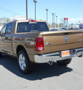 ram ram pickup 1500 2011 saddle brown pearl big horn gasoline 8 cylinders 4 wheel drive 5 speed automatic 99212