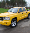 dodge dakota 2008 yellow slt gasoline 6 cylinders 4 wheel drive 4 speed automatic 44024