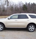 dodge durango 2011 gold suv citadel gasoline 6 cylinders all whee drive not specified 44024