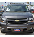 chevrolet tahoe 2011 dk  gray suv lt flex fuel 8 cylinders 2 wheel drive automatic 77090