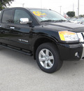 nissan titan 2011 black sl flex fuel 8 cylinders 4 wheel drive automatic 33884