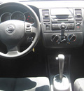 nissan versa 2011 white hatchback s gasoline 4 cylinders front wheel drive automatic 33884