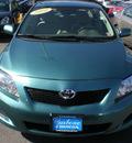 toyota corolla 2010 green sedan gasoline 4 cylinders front wheel drive automatic 13502