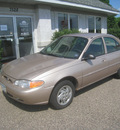 ford escort 1999 tan sedan se gasoline 4 cylinders front wheel drive automatic 55016