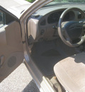 ford escort 1999 tan sedan se gasoline 4 cylinders front wheel drive automatic 55016