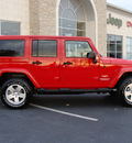 jeep wrangler unlimited 2011 red suv sahara gasoline 6 cylinders 4 wheel drive automatic 60915