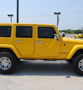 jeep wrangler unlimited 2011 yellow suv sahara gasoline 6 cylinders 4 wheel drive automatic with overdrive 76087