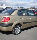 kia rio 2009 tan sedan gasoline 4 cylinders front wheel drive automatic 13502
