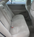 toyota camry 2004 tan sedan gasoline 4 cylinders front wheel drive automatic with overdrive 13502