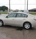 nissan altima 2009 tan sedan 2 5 sl gasoline 4 cylinders front wheel drive automatic 56001