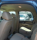 chevrolet tahoe 2011 brown suv ltz flex fuel 8 cylinders 4 wheel drive automatic with overdrive 55391