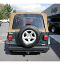 jeep wrangler 2001 dk  green suv sahara gasoline 6 cylinders 4 wheel drive 5 speed manual 08844
