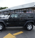 jeep wrangler unlimited 2010 black suv sport gasoline 6 cylinders 4 wheel drive automatic 33021