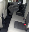 jeep wrangler unlimited 2010 black suv sahara gasoline 6 cylinders 4 wheel drive 6 speed manual 62034