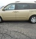 kia sedona 2009 gold van lx gasoline 6 cylinders front wheel drive automatic 43228