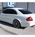 mercedes benz e class 2004 white sedan e55 amg gasoline 8 cylinders rear wheel drive automatic 77037