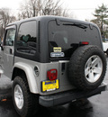 jeep wrangler 2002 silver suv sport gasoline 6 cylinders 4 wheel drive 5 speed manual 07730