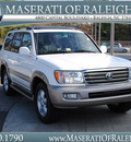 toyota land cruiser 2004 white suv gasoline 8 cylinders 4 wheel drive automatic 27616