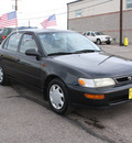 toyota corolla 1997 black sedan dx gasoline 4 cylinders front wheel drive 5 speed manual 80229